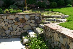 rock retaining wall and stone slab steps