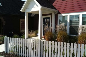 white picket fence and ornamental grasses