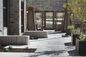 stone benches and steel planters
