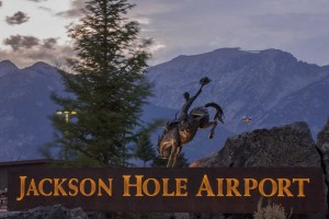"""Jackson Hole Airport Entry Sign with """"Battle of Wills"""" Sculpture (Photo by Bart Walter)"""